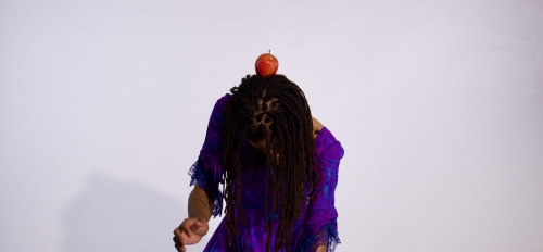 dancer with an apple on their head