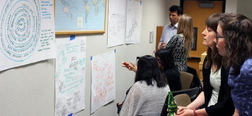 Nonprofit leaders and managers study organizational charts