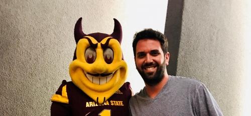Graduating ASU student Anthony Celaya poses with Sparky the Sun Devil / Courtesy photo