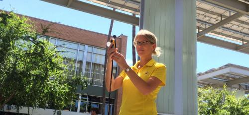 Ariane Middel in front of Memorial Union with meteorological instrument