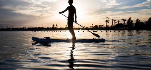 Man paddleboarding.