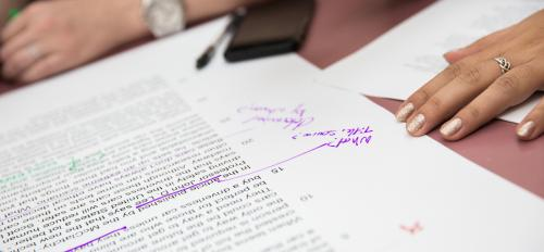paper with edits on table