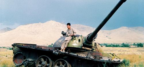 Afghani sitting on tank