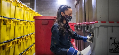 Woman inspecting biowaste