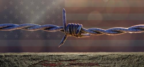 U.S. flag and barbed wire