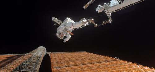 Astronaut Scott Parazynski repairs a damaged solar panel on the International Space Station.