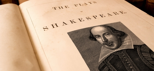 """Book open to a page with a photo of William Shakespeare that reads, """"The Plays of Shakespeare."""""""