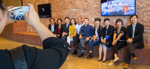 Chinese business and governmental executives pose for a group photo