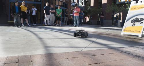 ASU engineering students test a self-driving miniature car.