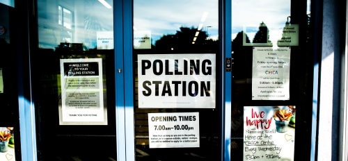 sign on door that says, 'polling station'