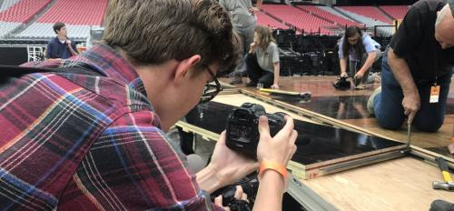 Senior Blake Benard captures a photo as the Final Four court is installed at University of Phoenix Stadium. (photo by Fabian Ardaya)