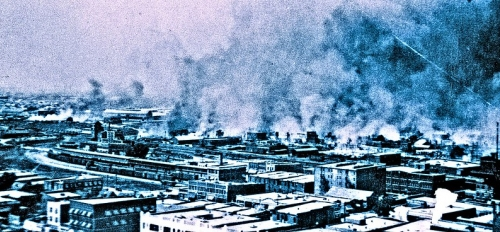historical photo of town on fire