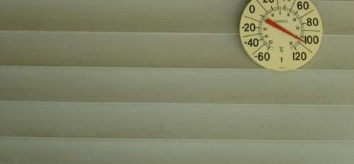 A wall with a thermometer.