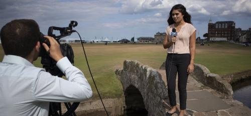 Woman holding microphone on bridge