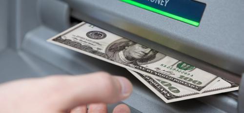 ATM machine dispenses cash