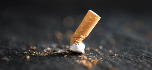 cigarette butt on abstract background