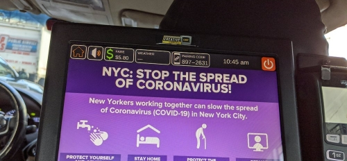 screen in taxi with information on how to stop the spread of coronavirus