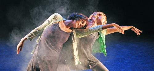 two women dancing on stage