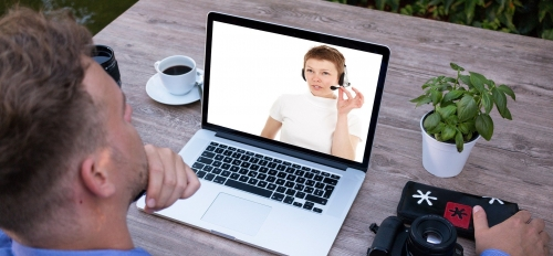 people having a telecall on a laptop