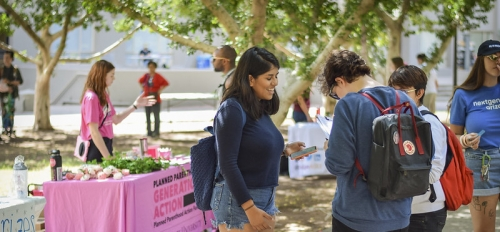 ASU students talking at the Student Services Lawn at ASU Tempe campus on National Voter Registration Day 2019