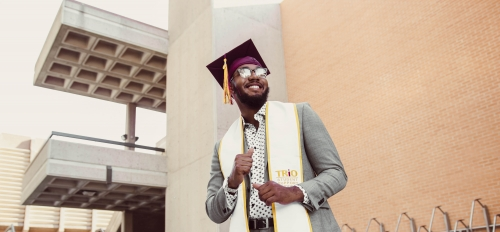 ASU grad Cortez Davis in his cap and stole