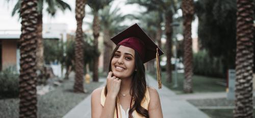 ASU grad Lucia Garcia on Palm Walk at ASU's Tempe campus