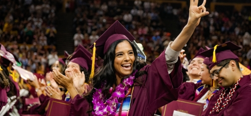 student at ASU Hispanic Convocation making a pitchfork with her hand