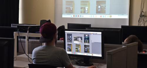 Student looks at photos on computer screen