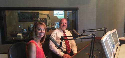 ASU Prep Digital CEO Julie Young and retired Utah Sen. Howard Stephenson sit in front of radio mics