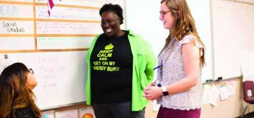Copper Trails Principal Stacy Ellis, center, oversees efforts to prepare teacher candidates for the classroom.