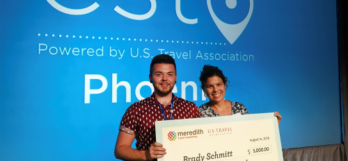 ASU senior Brady Schmitt and Community Resources and Development faculty member Rebekka Goodman hold Schmitt's scholarship check from Meredith Corporation