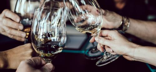 An image of people toasting with wine glasses