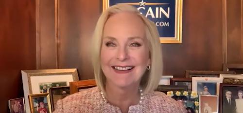 screenshot of Cindy McCain smiling at camera in Zoom meeting