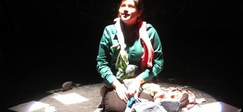 """actress on stage performing in the play """"Women of Ciudad Juarez"""""""