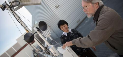 Allen Wright and Yun Ge check on the weather station used by researchers at ASU