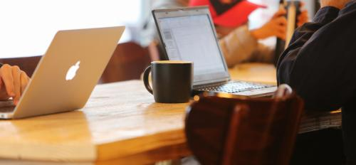 photo of laptops in coffee shop