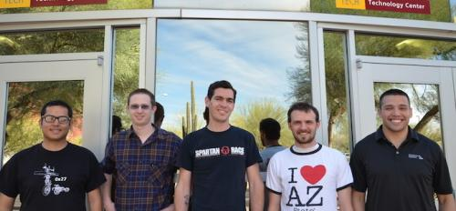 group photo of five ASU students in front of building