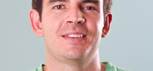 headshot of male Daniel Culotta wearing green t-shirt with brown hair and eyes