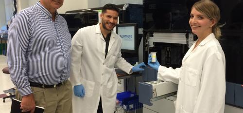 ASU alumnus Dan Kolk with two lab assistants at Hologic