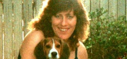 woman posing with beagle