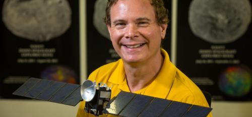 ASU associate research professor David Williams with model of Dawn spacecraft