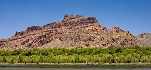 the Salt River running along the base of a mountainous terrain
