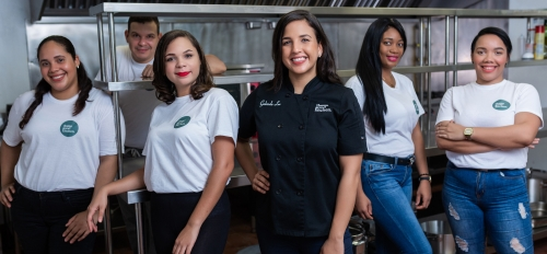Gabriela Lee (center) and the Damn Good Kitchen team. Photo credit: US State Dept.