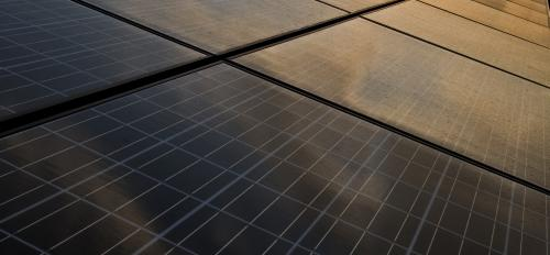The sun rises over the Verde Dickey Dome solar installation.