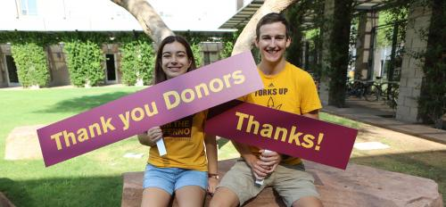 "students holding signs that say ""Thank you Donors"" and ""Thanks!"""