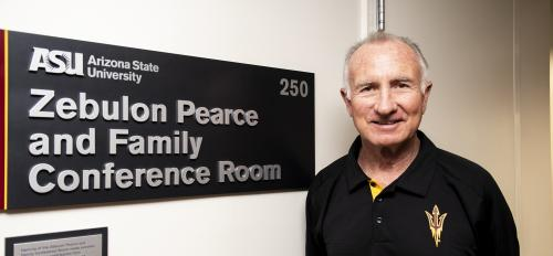 "Arthur ""Art"" Pearce II poses in front of the newly-unveiled Zebulon Pearce and Family Conference Room at Armstrong Hall."