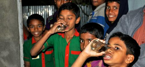 Children drinking water.