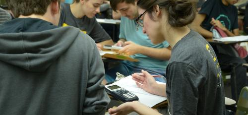 Students dig in to solve their first cipher during Cryptorally 2017