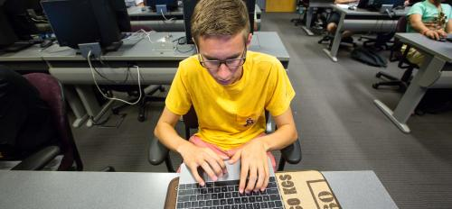 Eric working in a computer lab