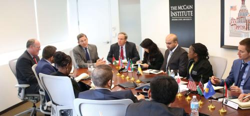 The McCain Institute's Ethan Kapstein leads a meeting in Washington, D.C.